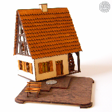 Dieser farbige Holzbausatz ist eine alte urige <strong>Wassermühle</strong> als erzgebirgisches <strong>Rauchhaus</strong>. Alle Teile sind fertig ausgeschnitten und farbig gemacht.